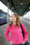 Girl on railway station platform Royalty Free Stock Photos