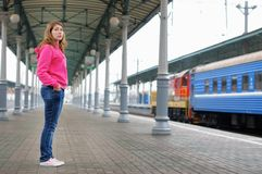 Girl on railway station platform Stock Image