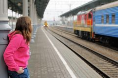Girl on railway station platform Royalty Free Stock Photography