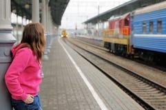 Girl on railway station platform Royalty Free Stock Photography
