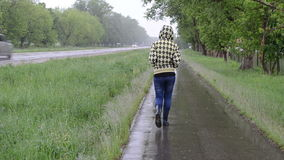 Girl rain walk road stock footage
