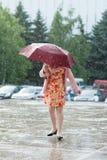 Girl, rain, weather, natural disaster, rain, child , umbrella, water, kid Royalty Free Stock Images