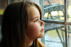Girl and rain Stock Images