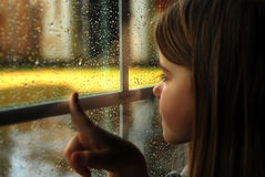 Girl and rain Stock Image