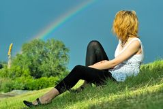 Girl and rainbow Stock Image