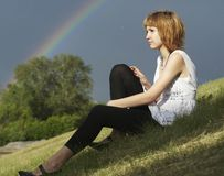 Girl and rainbow Royalty Free Stock Photos