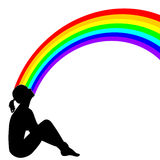 Girl with Rainbow. Silhouette of a girl sitting and gazing at the rainbow Stock Photography