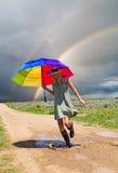 Girl and a rainbow royalty free stock photos