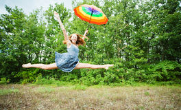 Girl with rainbow colored umbrella Stock Image