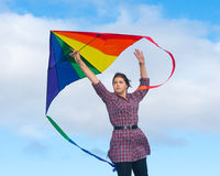 Girl with rainbow kite Royalty Free Stock Photo
