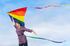 Girl with rainbow kite Royalty Free Stock Image