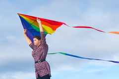 Girl with rainbow kite Royalty Free Stock Images