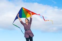Girl with rainbow kite Stock Photography