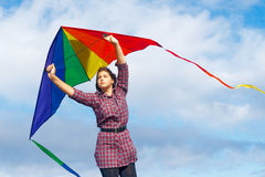 Girl with rainbow kite Royalty Free Stock Image