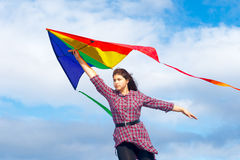 Girl with rainbow kite Stock Photo
