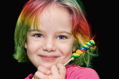 Girl with rainbow lollipop Royalty Free Stock Photo