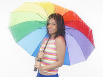 Girl with a rainbow umbrella Stock Photo