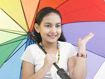 Girl with a rainbow umbrella Royalty Free Stock Photography