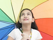 Girl with a rainbow umbrella Royalty Free Stock Image