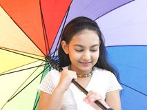 Girl with a rainbow umbrella Stock Image