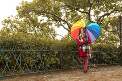 Girl with Rainbow Umbrella Stock Photography
