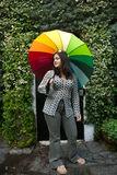 Girl with a rainbow umbrella. Girl playing with a rainbow umbrella in the garden Stock Image