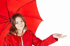 Girl in raincoat holding umbrella over white Royalty Free Stock Photography