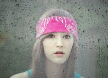 Girl in a Rainy Window Royalty Free Stock Images