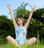 Girl with raised arms Stock Photo