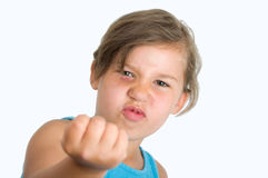 Girl with raised fist. Mad girl with blue eyes and a raised fist Stock Photography