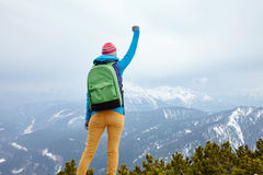 Girl with raised hand in mountains Royalty Free Stock Photos