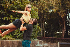 Girl raised by her boyfriend. Love romance outdoor fun playing concept. Girl raised by her boyfriend. Young women resting on arms of her man Royalty Free Stock Photography