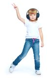 The girl raised her hand with headphones shows Stock Photo