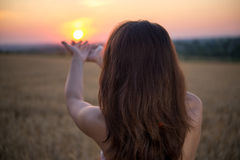 Girl raised her hands to sunset Royalty Free Stock Photo