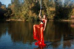 Girl raised her leg  dance, and dancing around  pole dance. Royalty Free Stock Photography