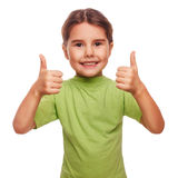 Girl raised her thumbs up smiling symbol indicates Stock Images