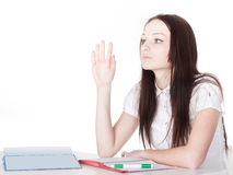 Girl raises her hand Royalty Free Stock Image