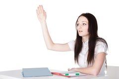 Girl raises her hand Royalty Free Stock Photography