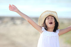 Girl raises her hands against blue sky Stock Images