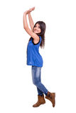 Girl raising hands Stock Image