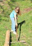 Girl with rake Stock Images