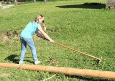 Girl with rake Stock Photo