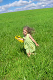 The girl ran across the field Royalty Free Stock Image