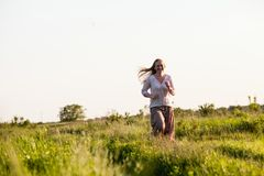 The girl ran across the field Royalty Free Stock Photos