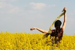 Girl in rape field Royalty Free Stock Images