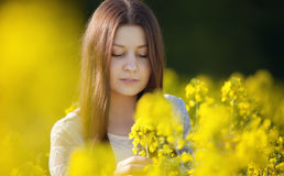 Girl in a rape field Stock Images