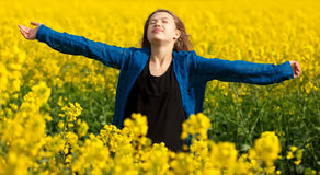 Girl in a rape field Royalty Free Stock Photography