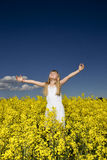 Girl on a Rape Field Royalty Free Stock Photo