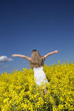 Girl on a Rape Field Royalty Free Stock Photos