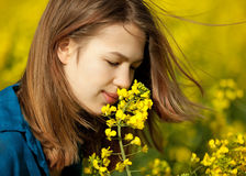 Girl in a rape field Royalty Free Stock Image
